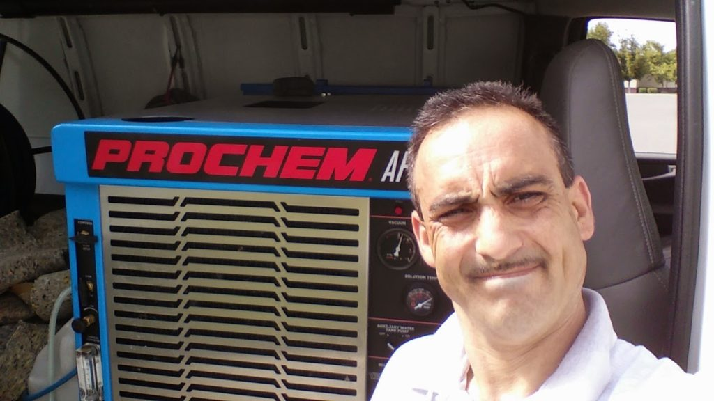 Tracy Wilson in front of his van ready to fix water damage to your home